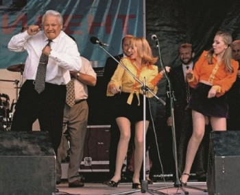Russian President Boris Yeltsin dances at a rock concert after a